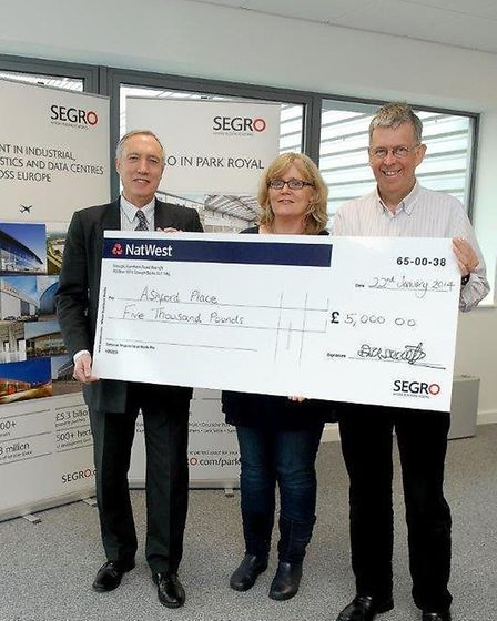 Martin Kidd from SERGO hands over a cheque to Renee Dolan, centre, and Danny Maher, left (pic credit
