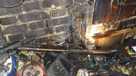 An eldrly couple had a lucky escape after a fire started in this cupboard under the stairs (Pic cred