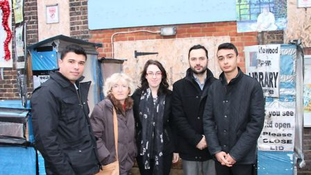 Ibrahim Taguri, far left, joins campaigners outside Cricklewood Library