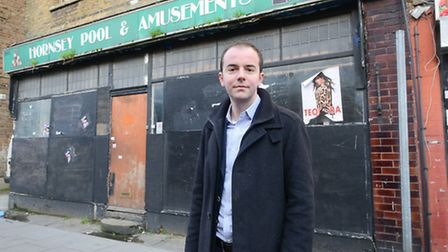 Cllr James Murray outside the building in Hornsey Road