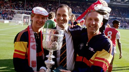 Arsenal manager George Graham (c) celebrates victory with physiotherapist Gary Lewin (l) and assista