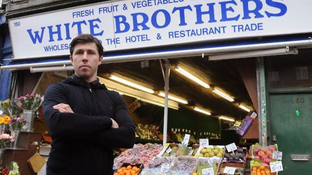 John Mackie in front of his greengrocer's shop in Finsbury Park