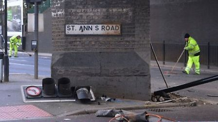 Workers clear the scene of the police chase death crash in Tottenham. Picture: Stefan Rousseau/PA Wi