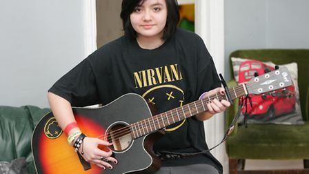 Singer and songwriter Charlie Raphael Campbell with her guitar