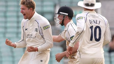 Middlesex's Ollie Rayner (centre) celebrates dismissing Surrey's Gareth Batty (out of picture).