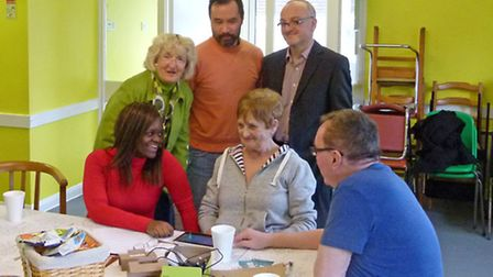 Elderly residents were given a free tablet in a special event in early March