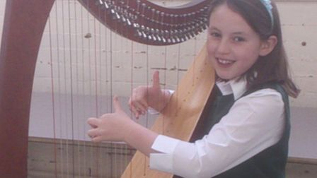 Carys Gwenllian Hinds will play the harp for the National Children's Orchestra