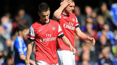 Arsenal's Laurent Koscielny (left) and Per Mertesacker stand dejected after conceding a goal