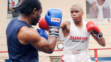 Islington BC's Reece Shagourie (right) on his way to victory against Kingsley Okolie
