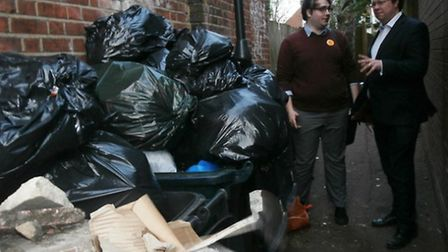 Paul Edgeworth and Dan Rogerson inspecting overflowing bins and dumped rubbish in Willesden Green