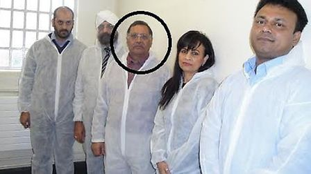 Navin Shah, circled, in a police cell
