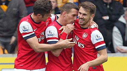 Arsenal's Lukas Podolski (centre) celebrates scoring his side's second goal with his team-mates
