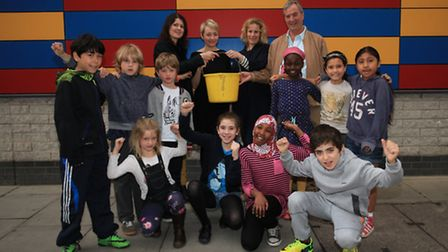 Pupils of Prior Weston Primary school cheer up after raising money for the Children's centre.