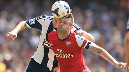 Arsenal's Olivier Giroud and West Bromwich Albion's Craig Dawson (left) battle for the ball