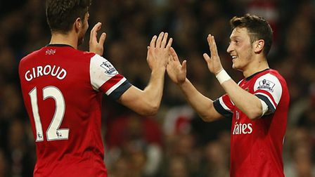 Arsenal's Mesut Ozil (right) celebrates scoring his side's second goal of the game with teammate Oli