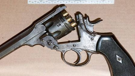 Police found two guns in the abandoned car