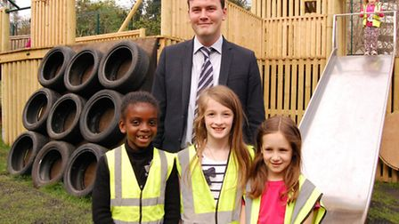 Cllr Caluori with young people at the reopening of the Three Corners Adventure playground