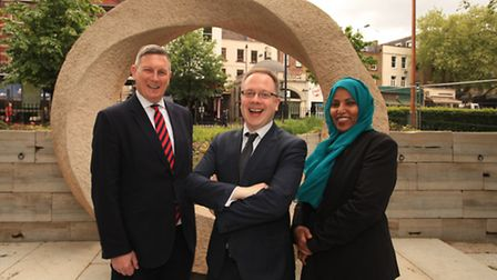 Cllr Poole, left, Cllr Watts, and Cllr Rakhia Ismail stand by the War Memorial on Islington Green,