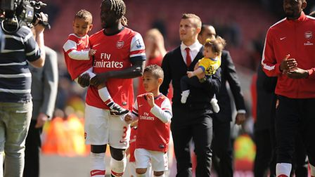 Arsenal's Bacary Sagna (left) and Jack Wilshere on the pitch after the final whistle