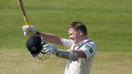Sam Robson celebrates his century for Middlesex against Nottinghamshire