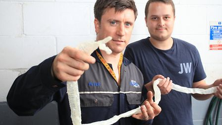 Garage owner Peter Das-Heffernan left, with office manager James Walls who found the snake skin.