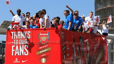 The Arsenal FC team celebrates their triumph over Hull City in the FA Cup final at Wembley in a para