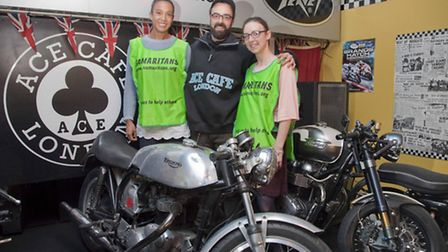 Kerry Smith, Samaritans branch director (left) with Carlos Paz, Ace Cafe Manager (centre) and Gemma