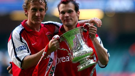 Arsenal goalscorers Ray Parlour and Fredrik Ljungberg celebrate with the FA Cup in 2002
