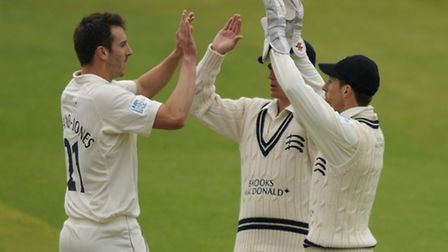 Toby Roland-Jones (left) celebrates a wicket for Middlesex against Lancashire