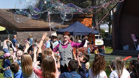 Entertainer Steff making giant bubbles as part of the popular Easter Egg Trail in Sparrow's Nest Gar