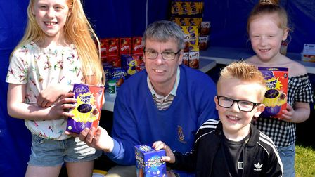 Lowestoft Lions president Michael Cook handing out Easter egg prizes PHOTO: Mick Howes