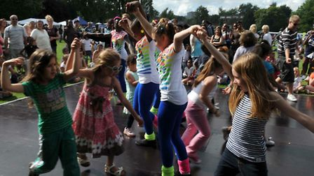Children try out their dancing shoes at the 2010 Kilburn Festival