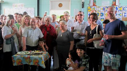 More than 100 resident attended the surpise party in honour of Barry Cheese, in front of table, (pic