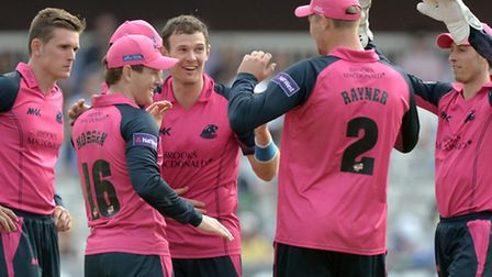 Middlesex Panthers' James Harris (centre) celebrates a wicket