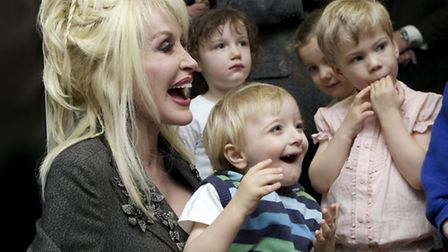 Dolly Parton with some young readers