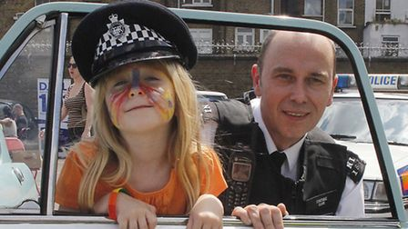 Kirsty Aston, 6, with Pc Phil Clarke. Pic: Tony Gay
