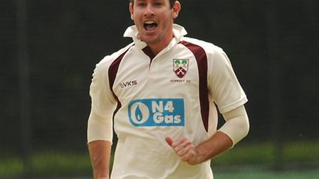 Michael Philipson celebrates the fall of a wicket