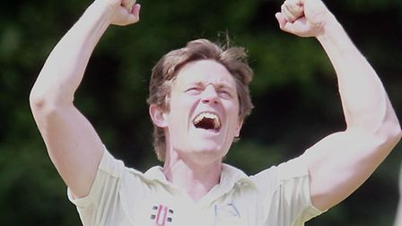 Craig Gourlay (L) of Highgate celebrates after capturing the wicket of Deepak Singh