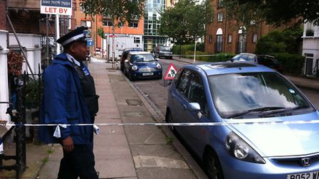 Police guard Horsell Road where the stabbing took place