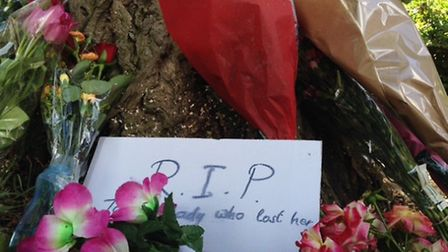Scores of flowers have been left at the scene (Pic credit: Myron Jobson)