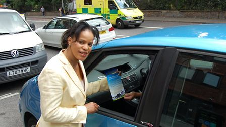 Cllr Claudia Webbe hands out Switch Off Your Engine leaflets to idling motorist