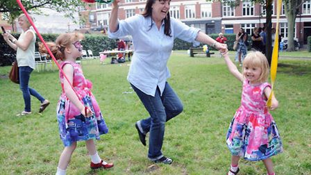 Pictured from left dancing around a maypole is Issabella 5 mum Tracey Bennett and Annabelle 3