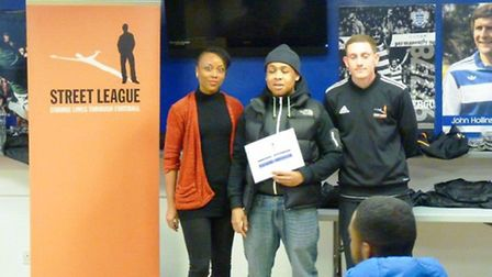 Cheryl Forde, left with David Headlam, centre, and Adam White, youth community coach, at the gradua