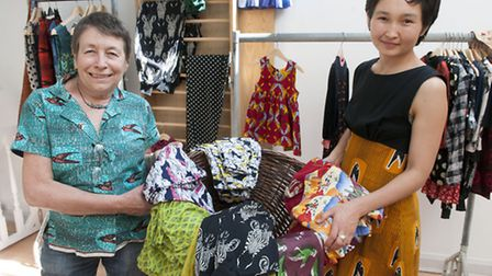 Teachers and clothes-makers Penny MacInnes and Aika Esenalieva open their new children's clothes sho