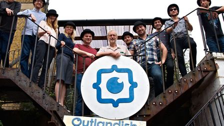 The Outlandish team with MP Jeremy Corbyn (centre) Harry Robbins (centre left) and Tamlyn Rhodes (se