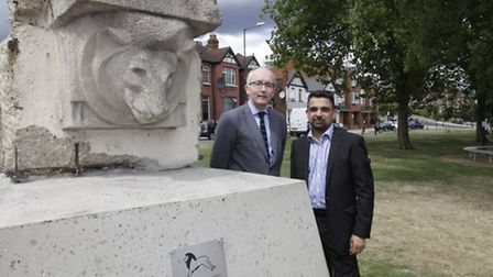 Julian Tollast, head of masterplanning and design at Quintain (left) poses by the historical plinth