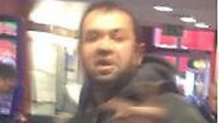 Police would like to speak to this man after a door was kicked in at William Hill in Cricklewood