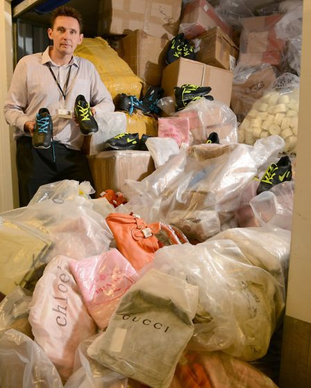 Andrew Clooney, senior prosecutor at Brent Council, with the haul -thought to be the largest ever by