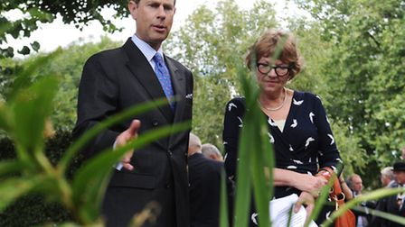 Prince Edward, Earl of Wessex walks around the gardens in Arlington Square