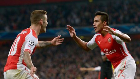 Arsenal's Alexis Sanchez (right) celebrates with team-mate Jack Wilshere